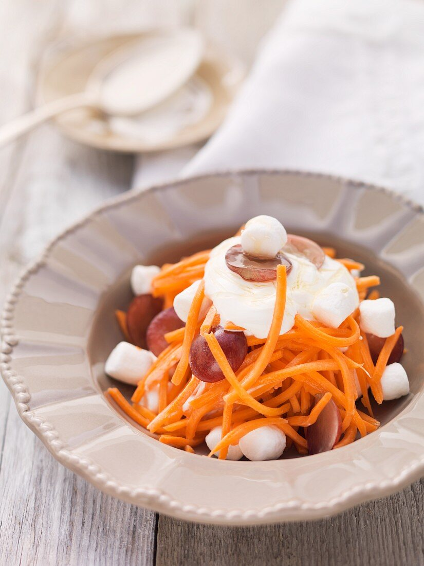 Carrot salad with grapes and marshmallows