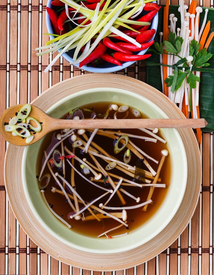 Broth with enoki mushrooms and vegetables (Asia)