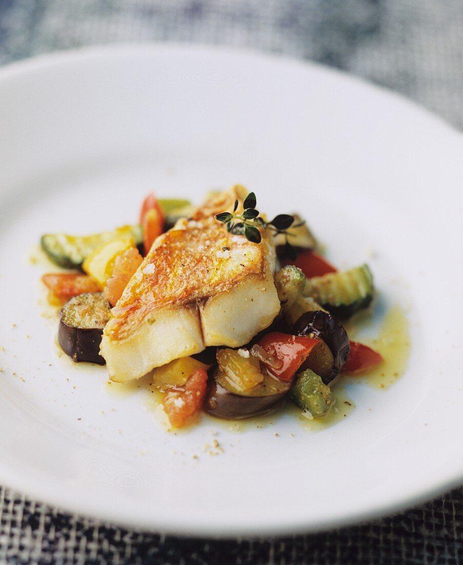 Fried fish fillet on Mediterranean vegetables