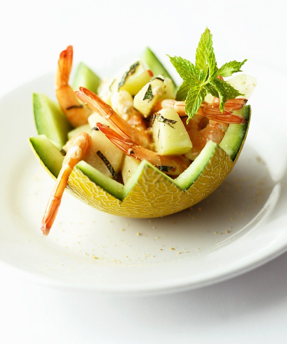 Prawn salad with melon and mint in a hollowed-out melon half