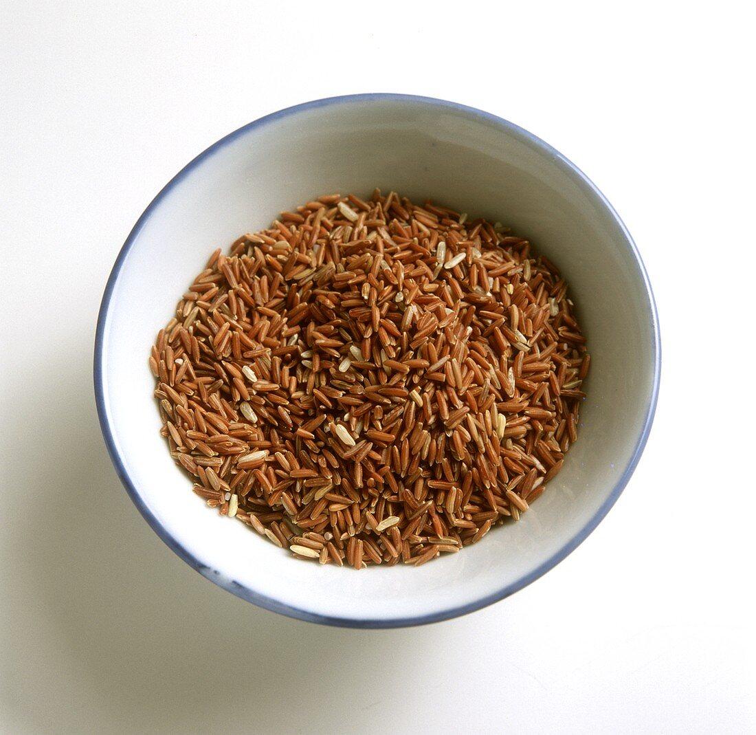 Red rice in enamel dish