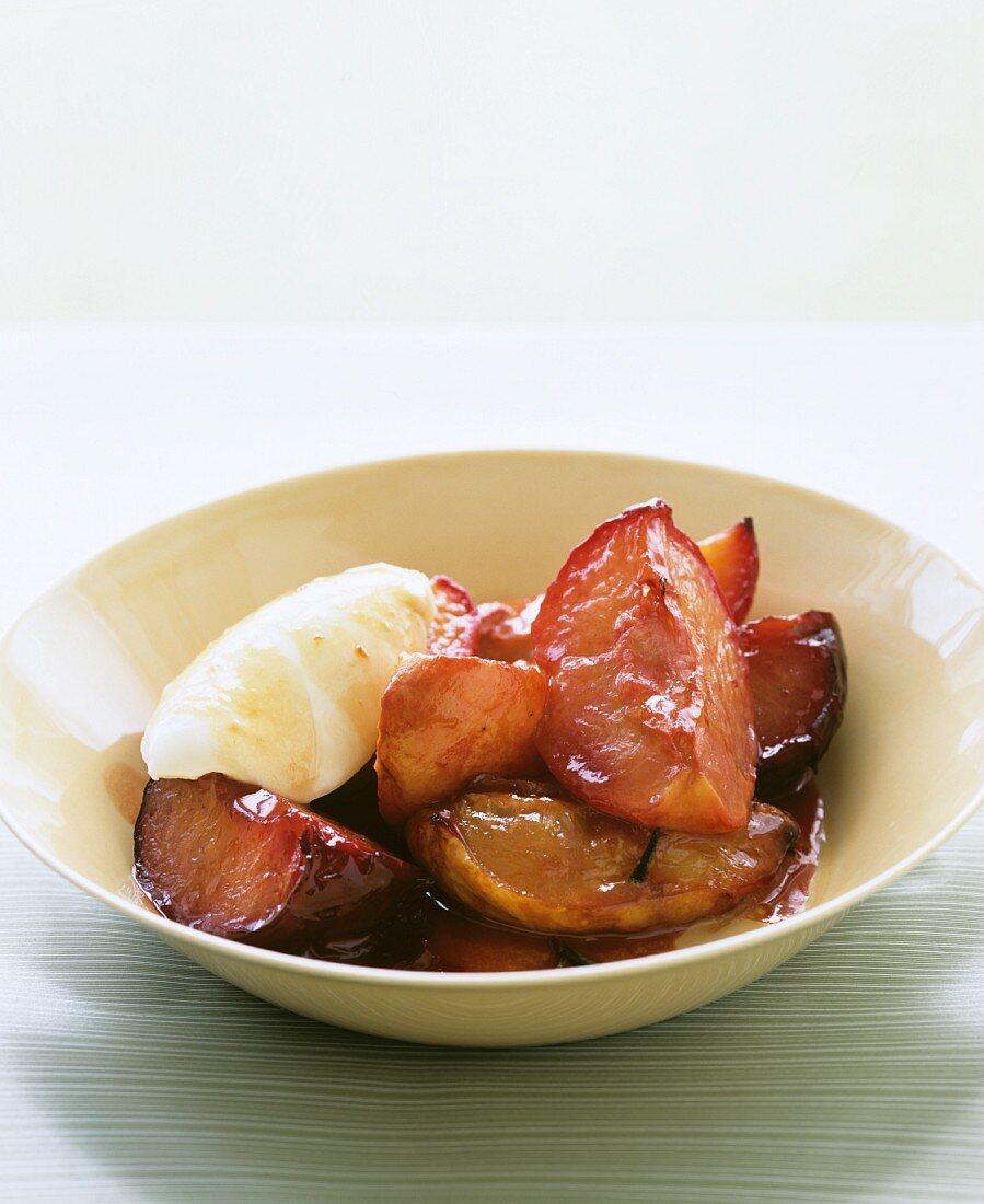Stewed plums with a dollop of whipped cream