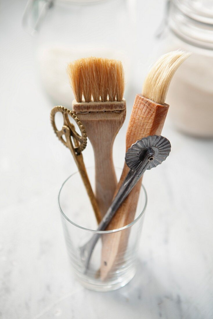Baking brushes and pastry wheels in a glass