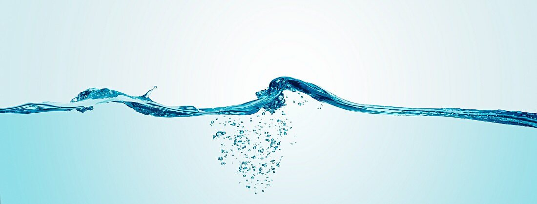 Water waves and air bubbles