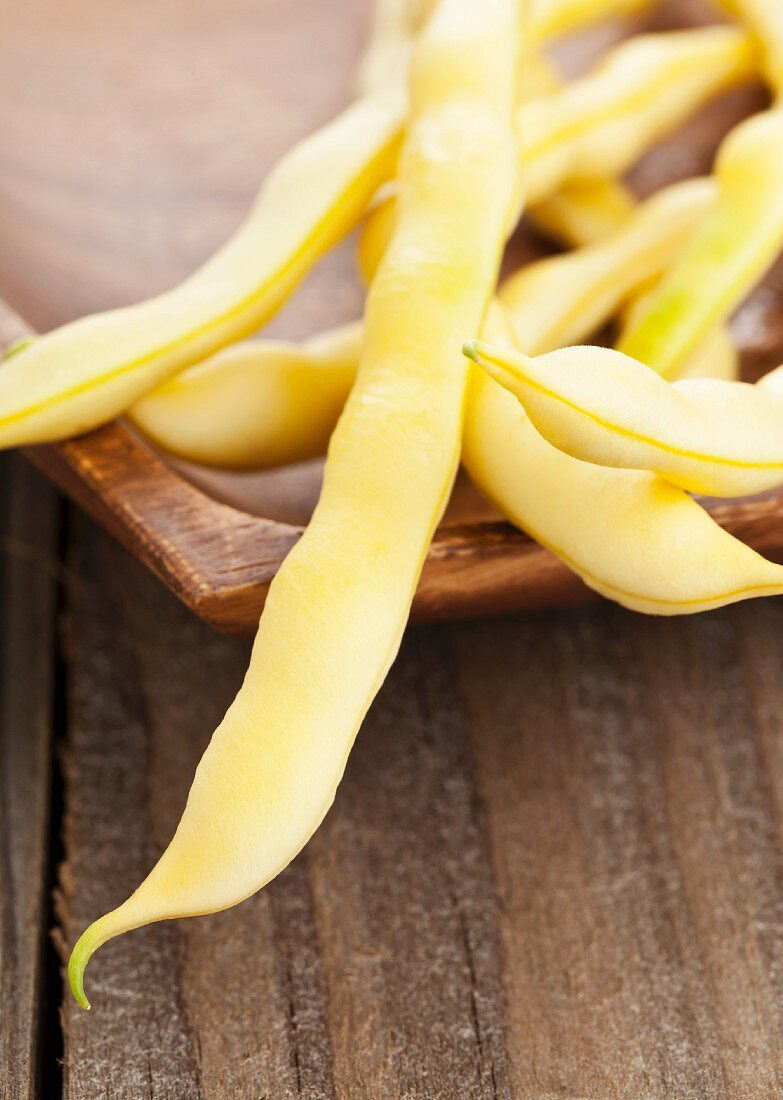 Yellow beans (wax beans) in a wooden dish