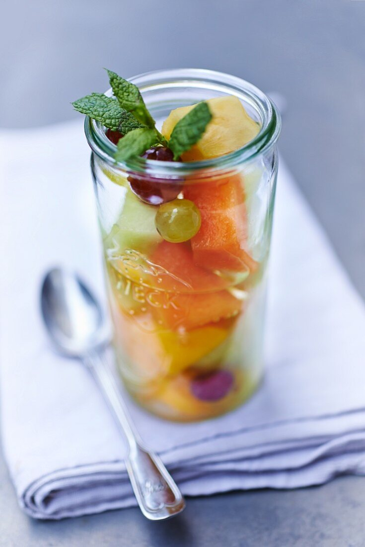 Fruit salad in a storage jar