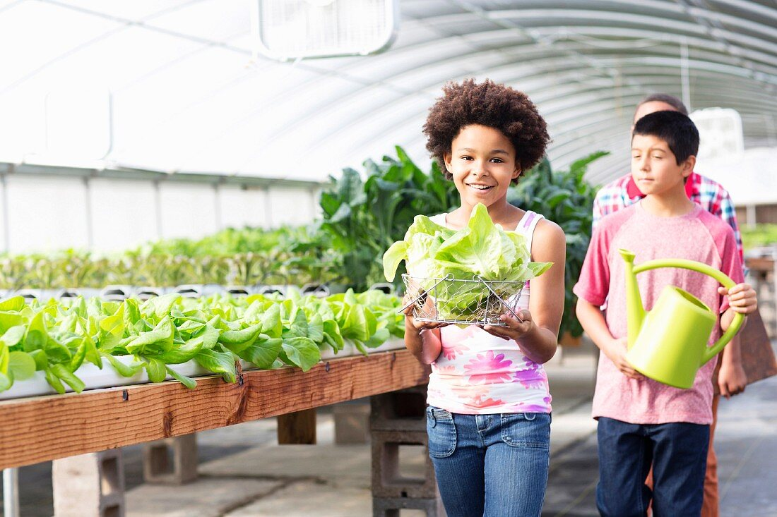 Children helping in a greenhouse