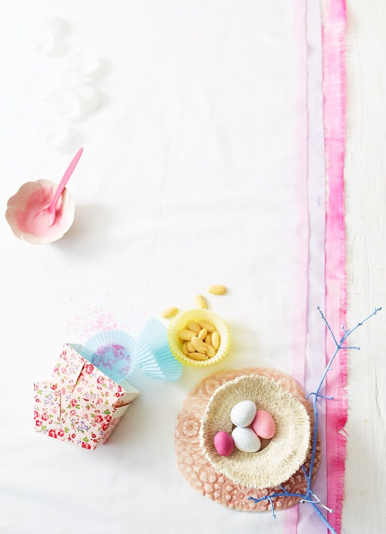 Easter eggs, paper cases, almonds and glacé icing