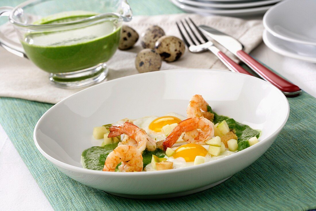Creamed spinach with prawns, apple and fried quail's eggs