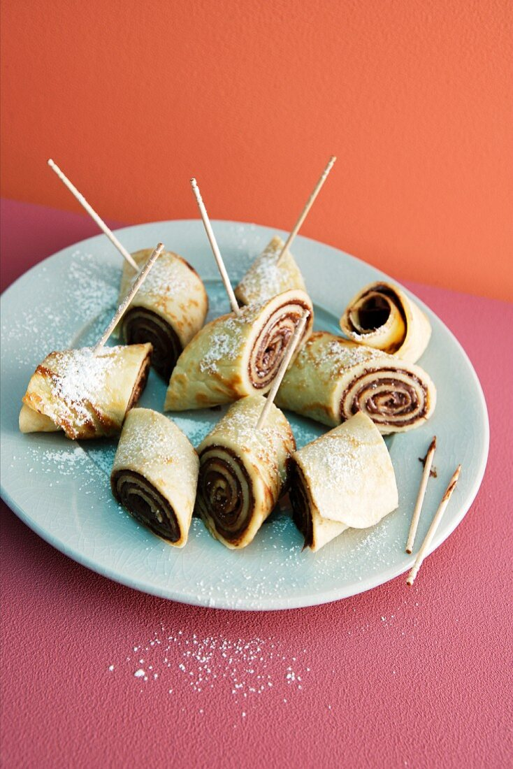 Rolled pancakes filled with hazelnut spread