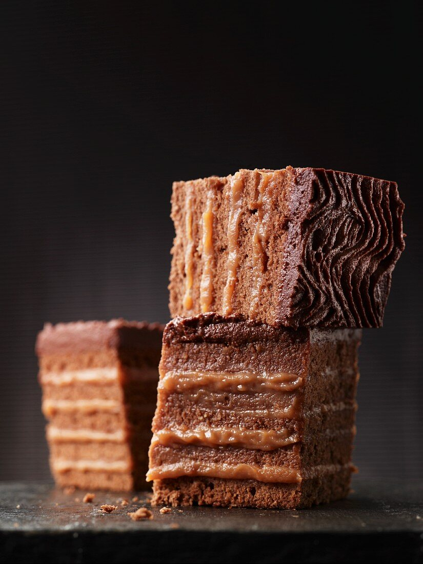 Individual Herrentorte (not too sweet layer cake topped with chocolate glaze) with quince jelly