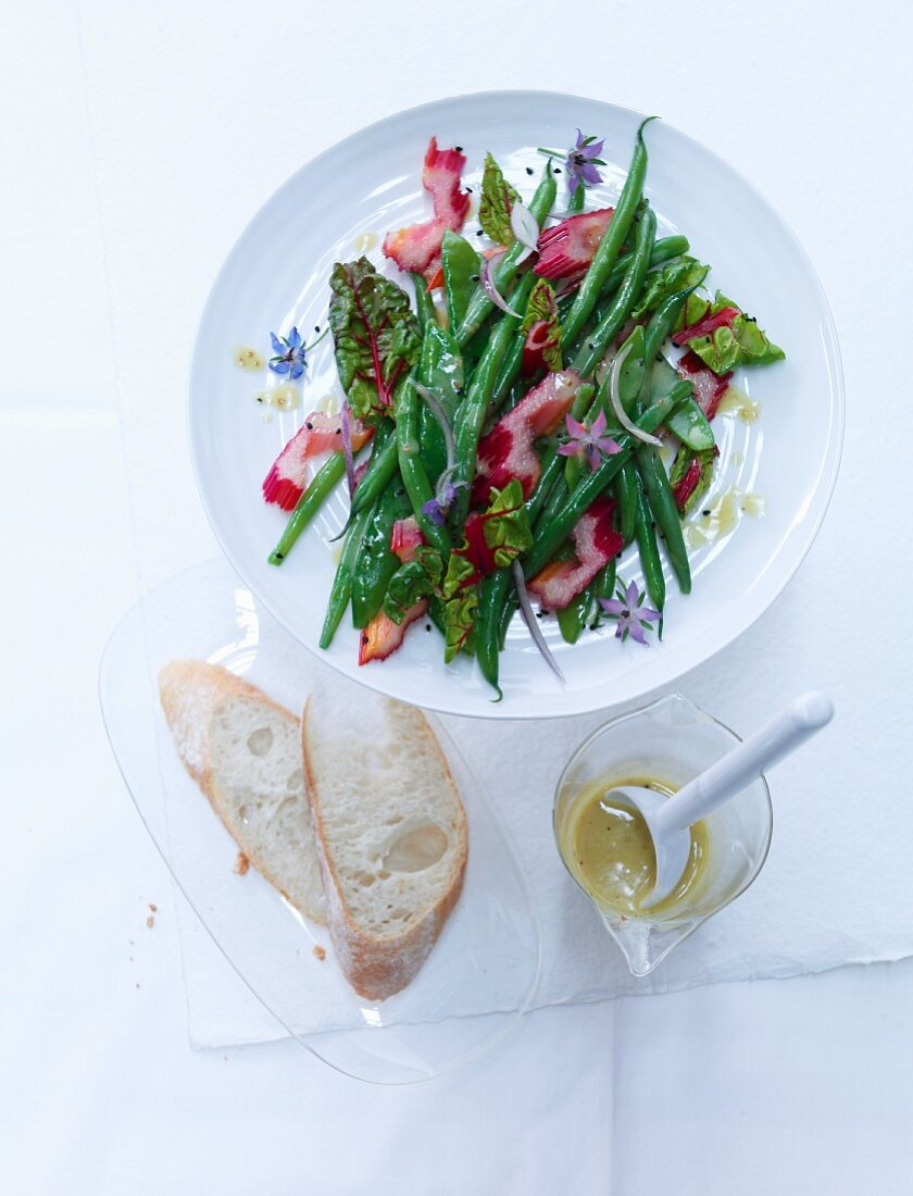 Bean and chard salad with mange tout and a lemon and mustard dressing