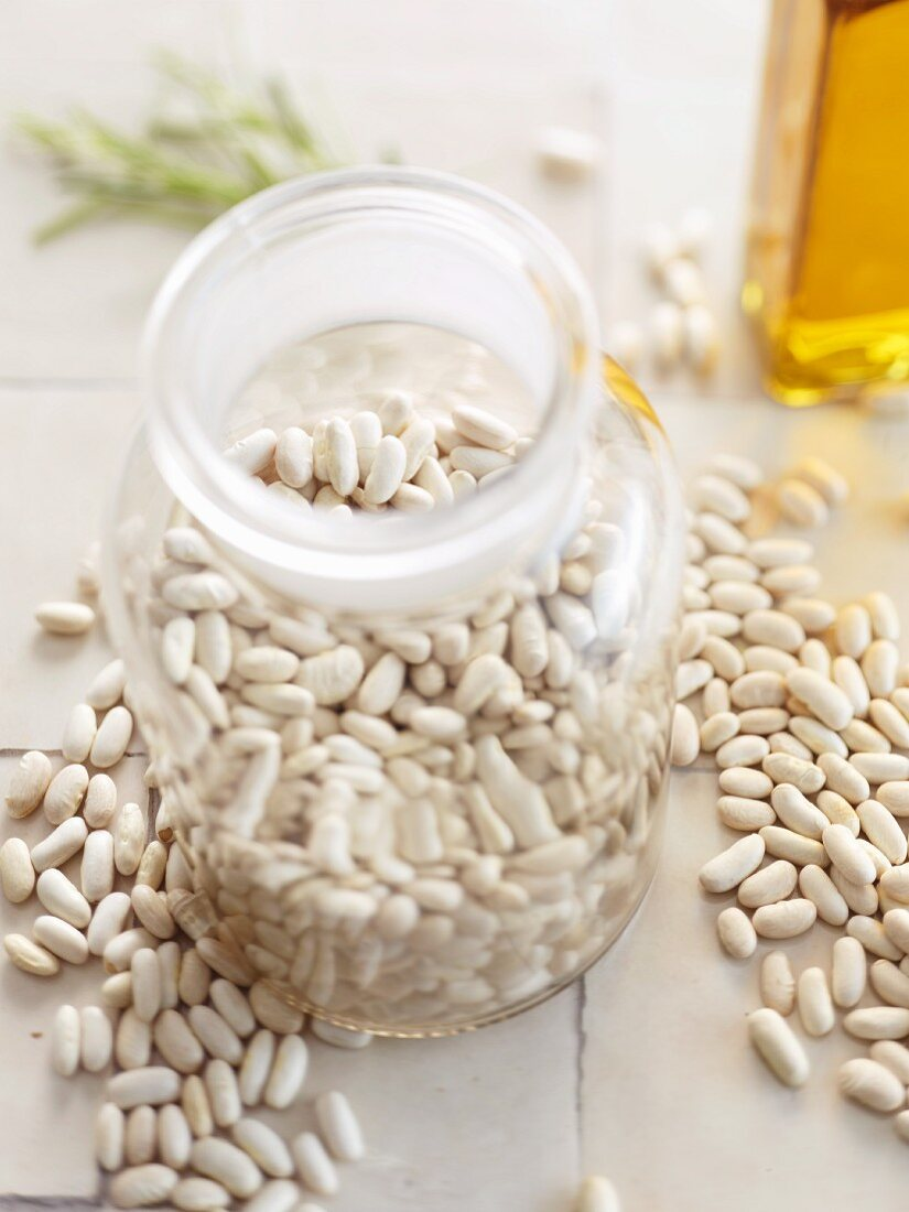 White beans in a storage jar and to one side