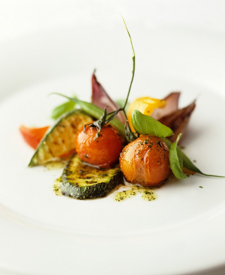 Fried courgette and cherry tomatoes with basil