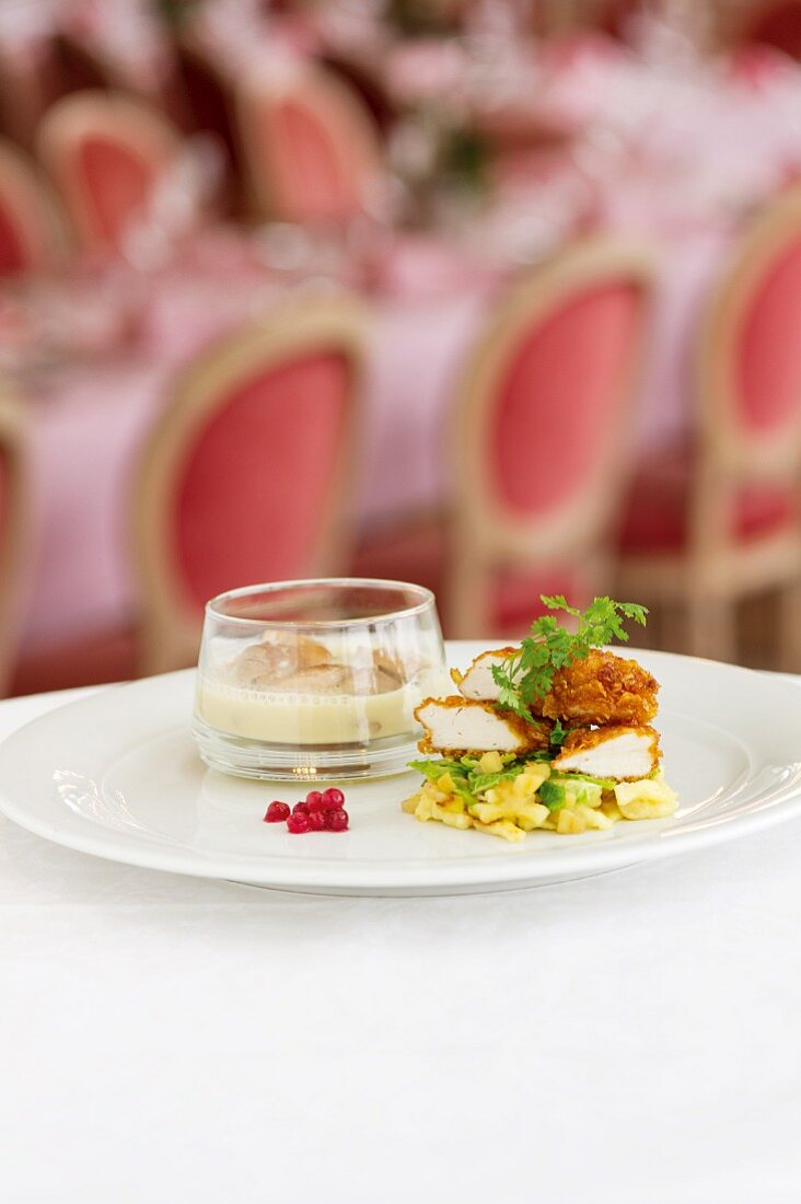 Cured chicken leg and crispy chicken breast with savoy cabbage and apples, cranberries and quark Spätzle (soft egg noodles from Swabia)