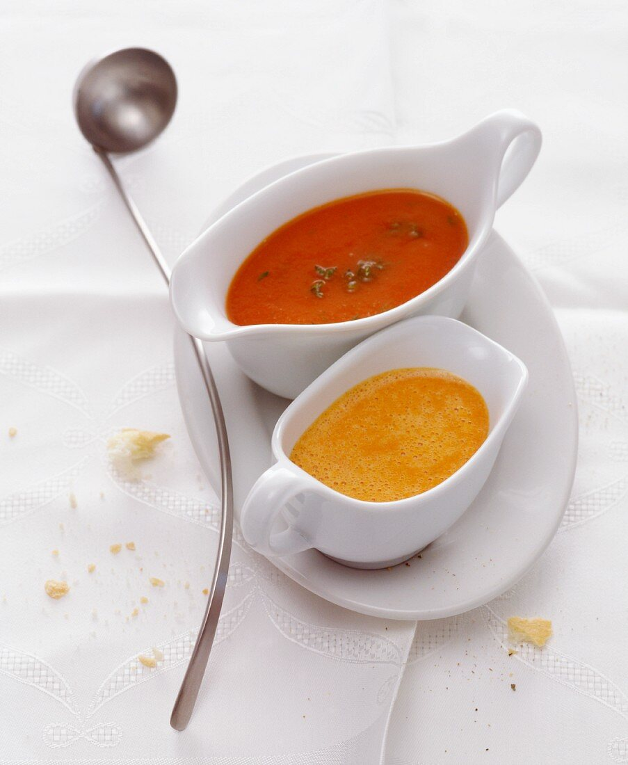 Tomato sauce and creamy paprika sauce in sauce boats