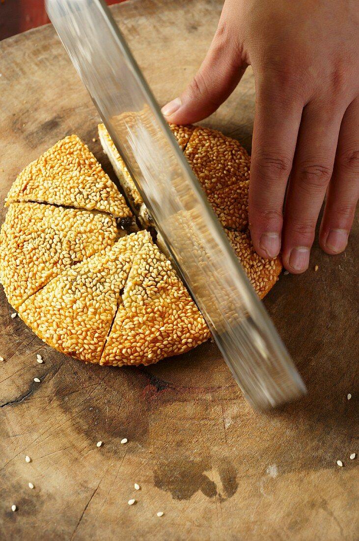 A loaf of golden, unleavened sesame seed bread