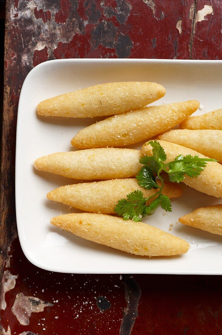 Corn fingers with grated coconut