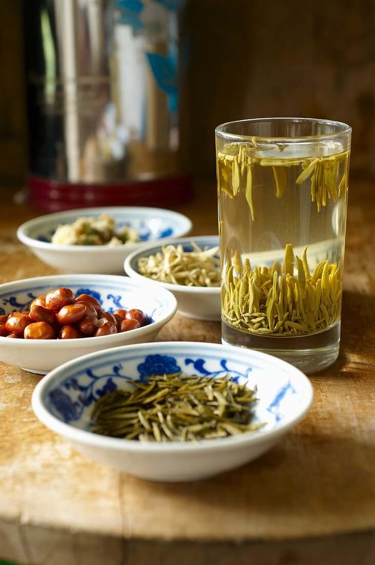 Arrangement of tea featuring green tea, honeysuckle tea and chrysanthemum tea