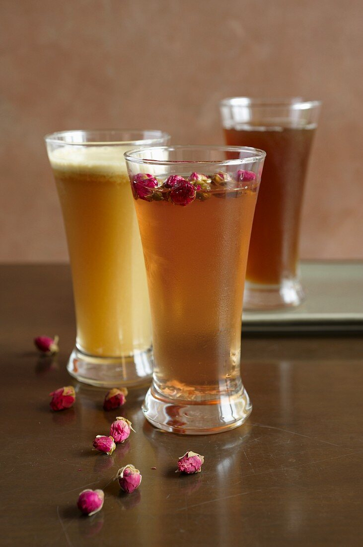 Apple juice with date purée, apple vinegar with rose petals in pineapple and lime juice and goldthread and date tea