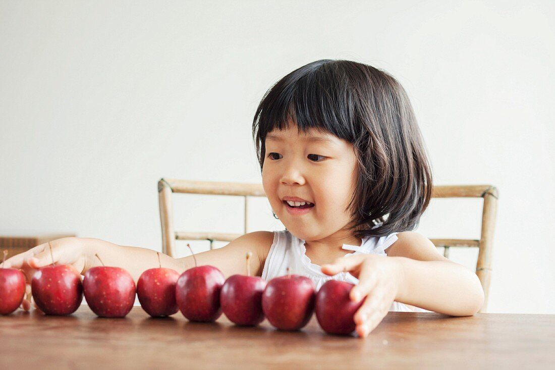 Girl with red apples, portrait