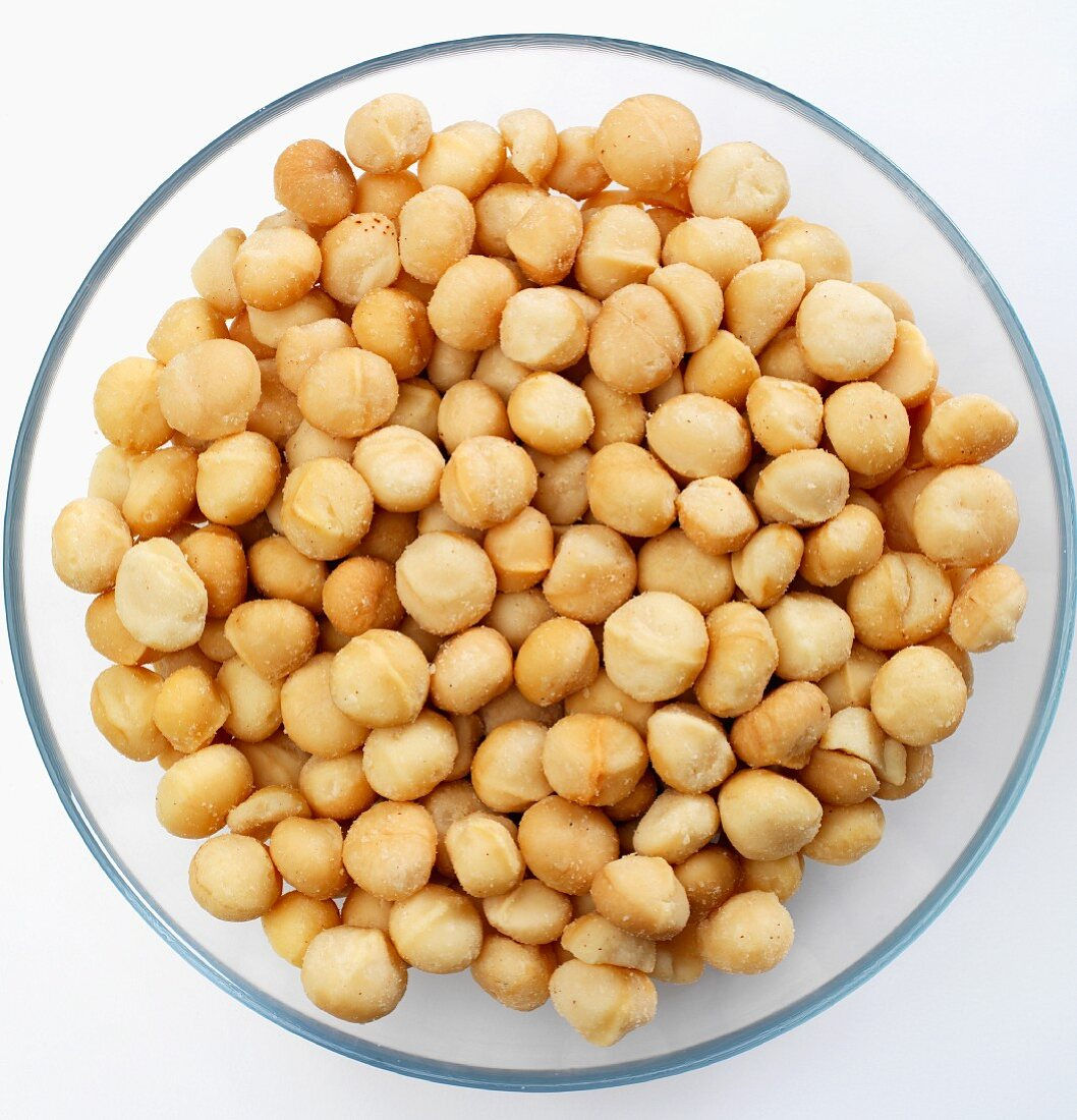 salted macadamia nuts in a bowl