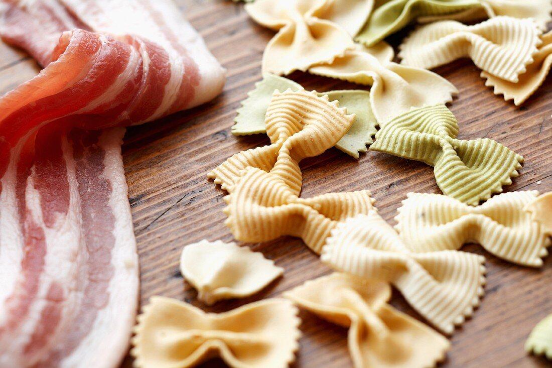 Uncooked Bacon and Tri-Color Bowtie Pasta