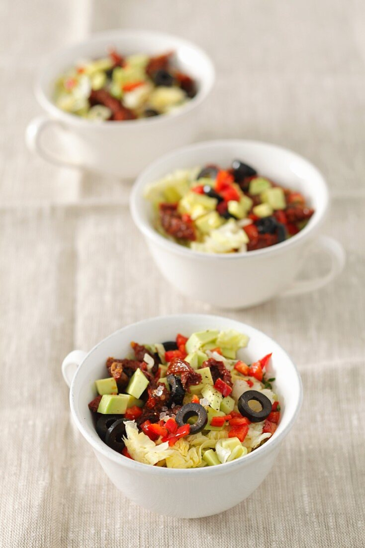 Iceberg lettuce with sundried tomatoes, avocado and olives