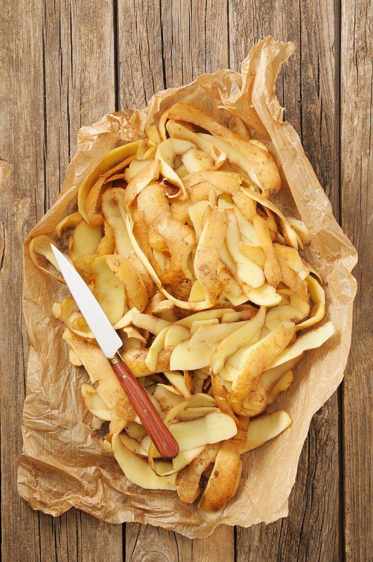 Potato peelings in paper