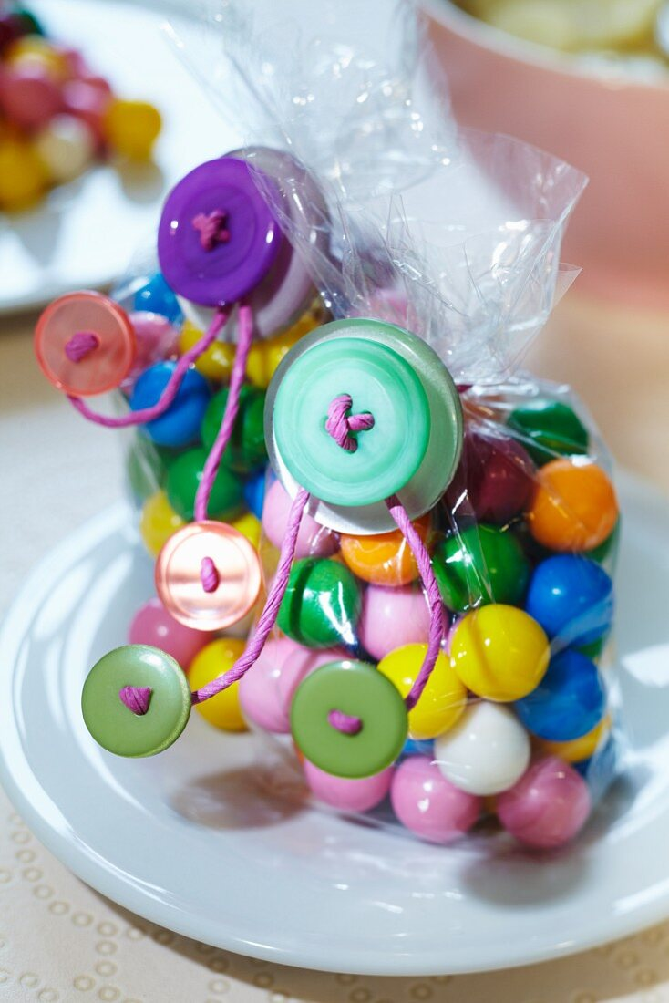 Bags of colourful sweets decorated with buttons