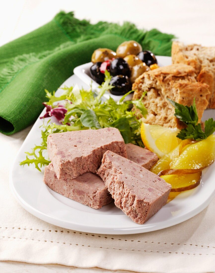 Ardennes pâté (meat paste, Belgium) with lettuce, bread and olives