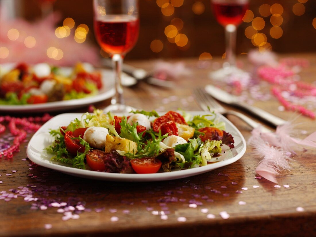 Tomato and mozzarella salad as part of a party buffet