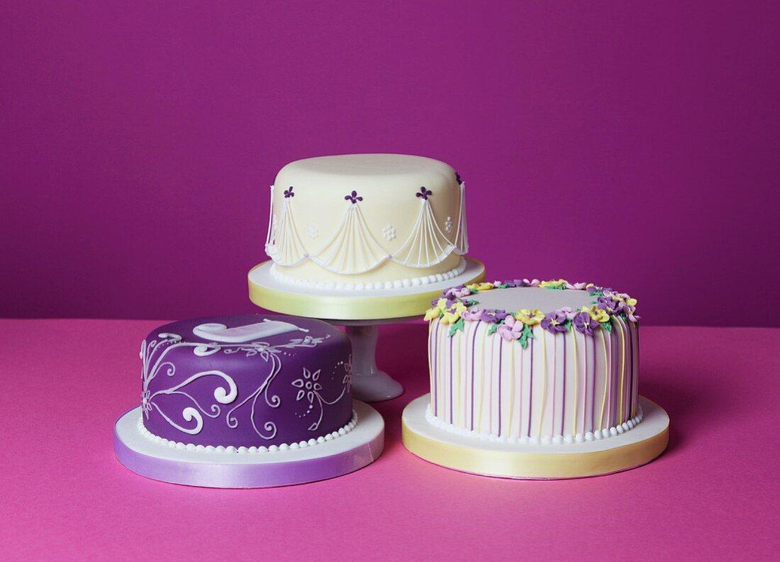 Three different celebration cakes