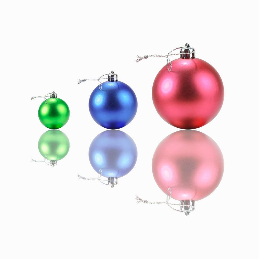Three Christmas tree baubles (red, blue, green)