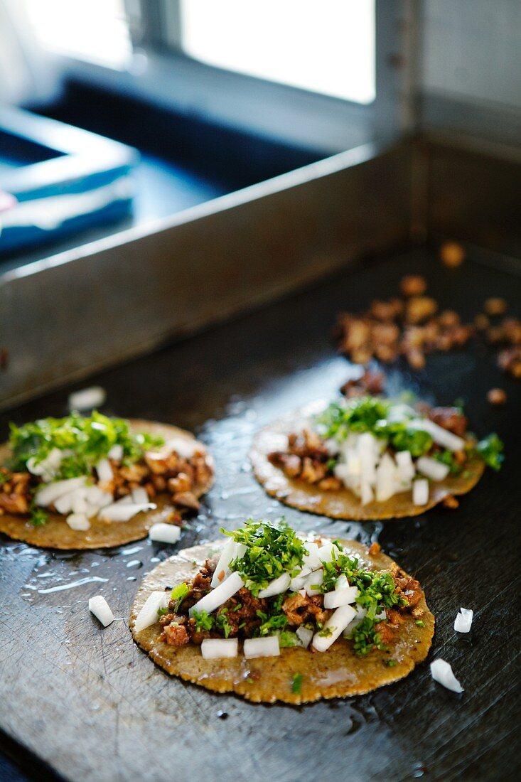 Taco al pastor (corn tortillas with pork, Mexico)