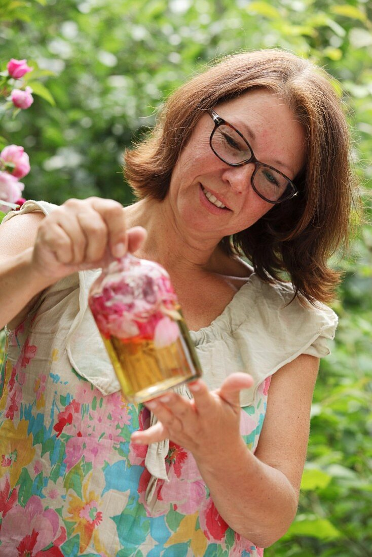 A woman making rose vinegar
