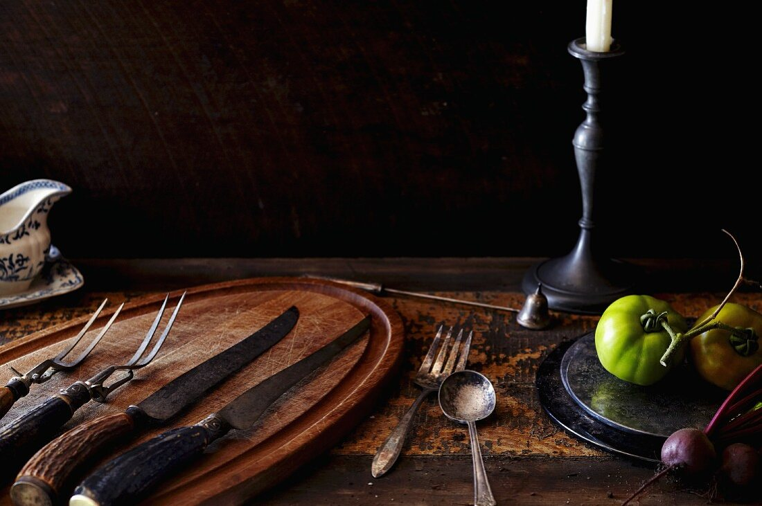 Rustic Table Setting with Knives, Forks and Tomatoes