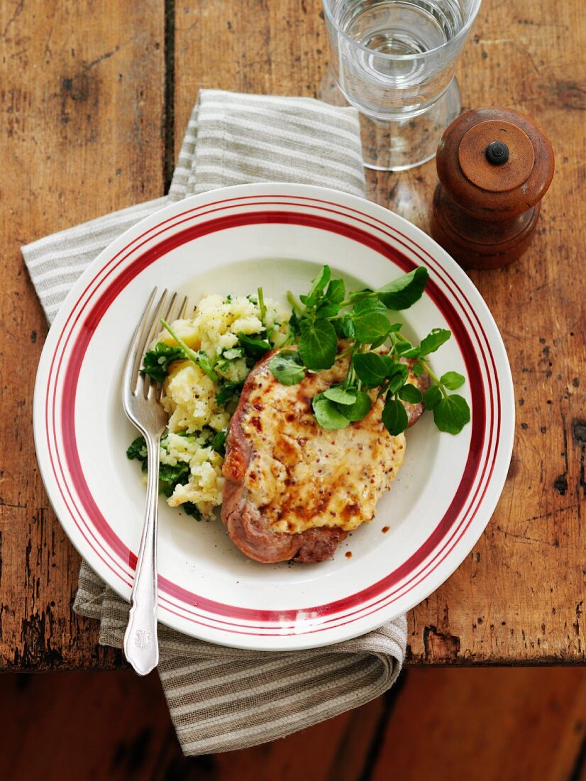 Pork cutlet with cheese and mashed potatoes