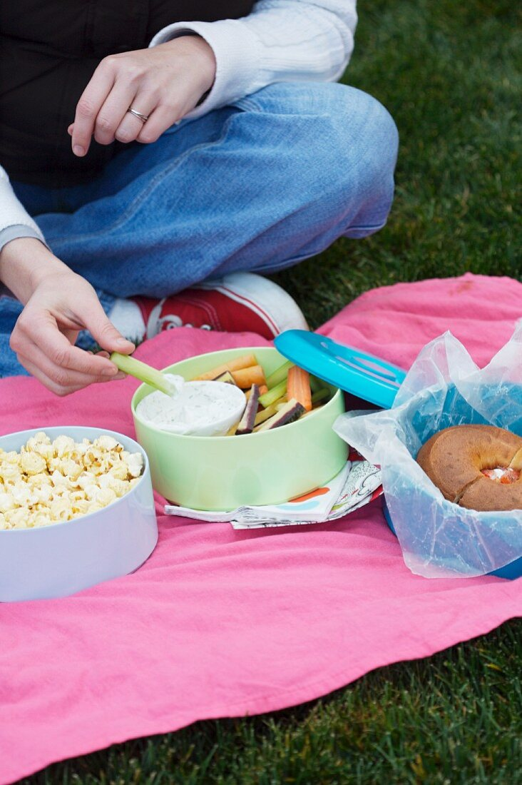Eating Outside; Popcorn, Crudite and a Bagel Sandwich
