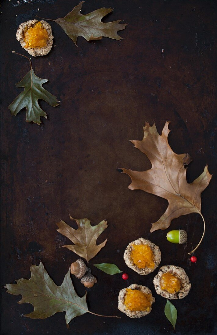 An Autumn Still Life With Leaves, Acorns and Amaranth Cookies topped with Pumpkin Jam