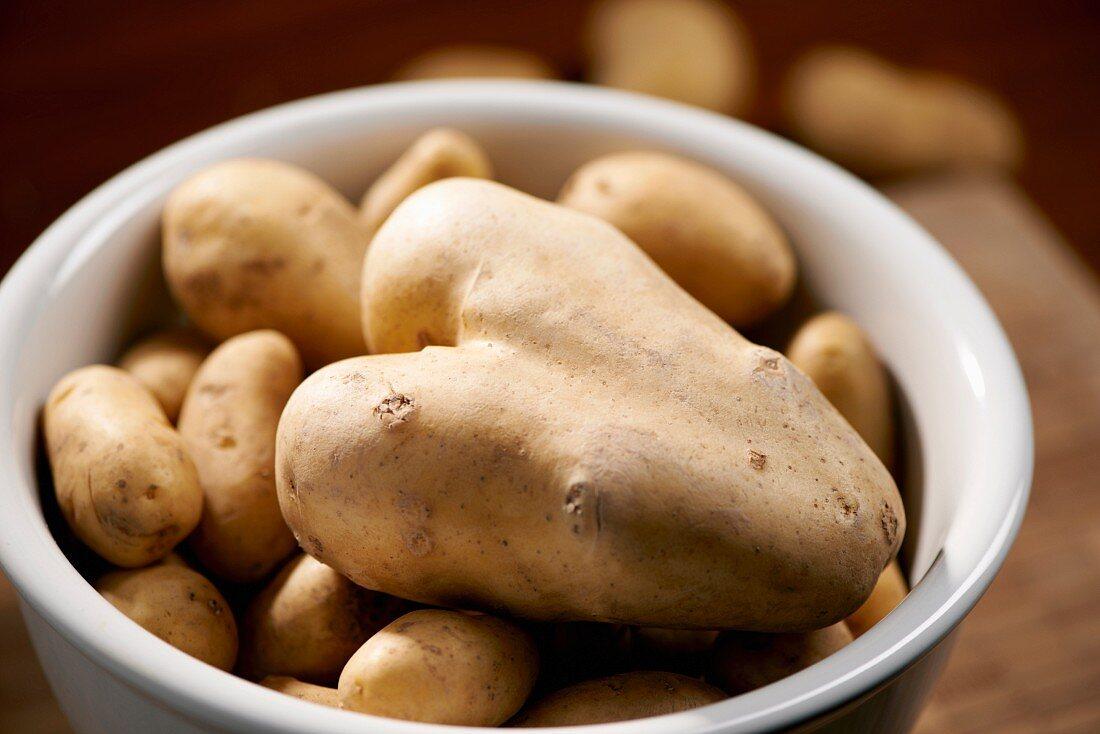 Potatoes in a bowl, one shaped like a heart