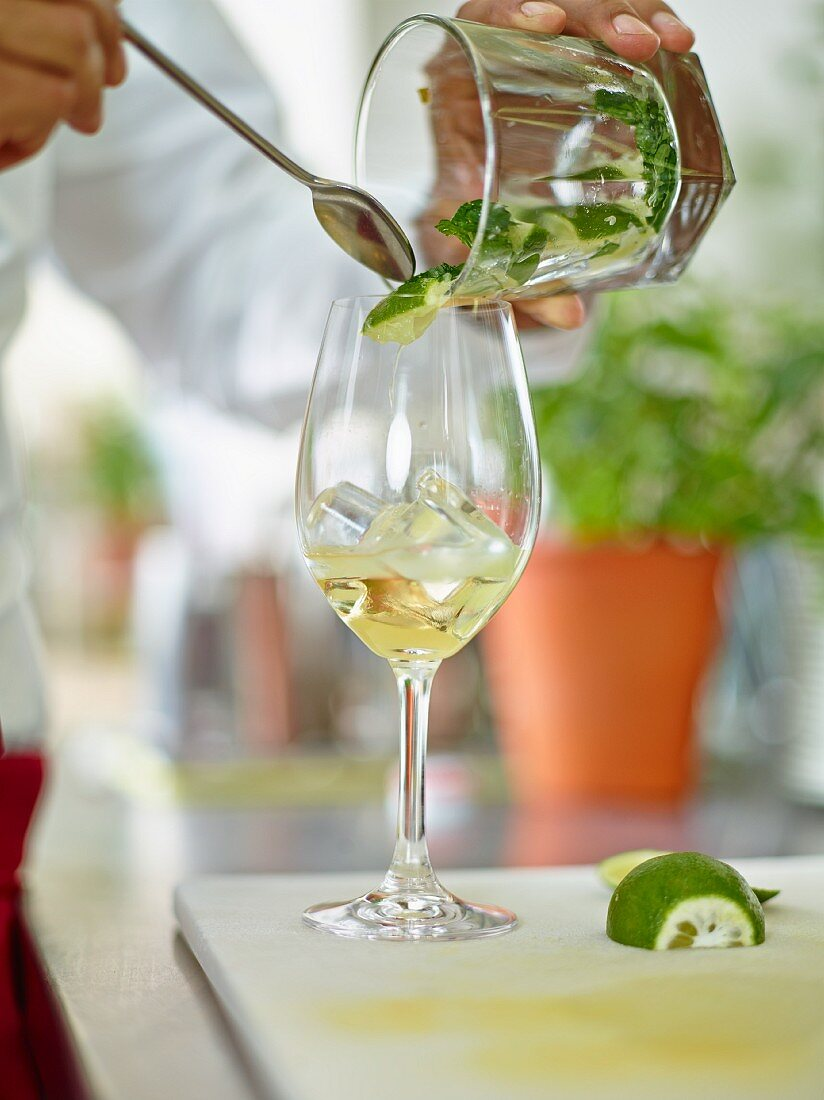 Hugo cocktail made with white wine, elderflower cordial and lime