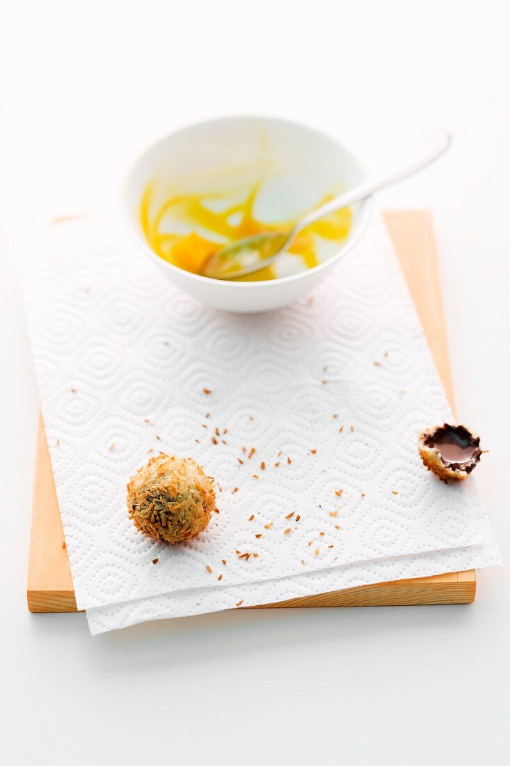 The remains of deep-fried chocolates with mango compote