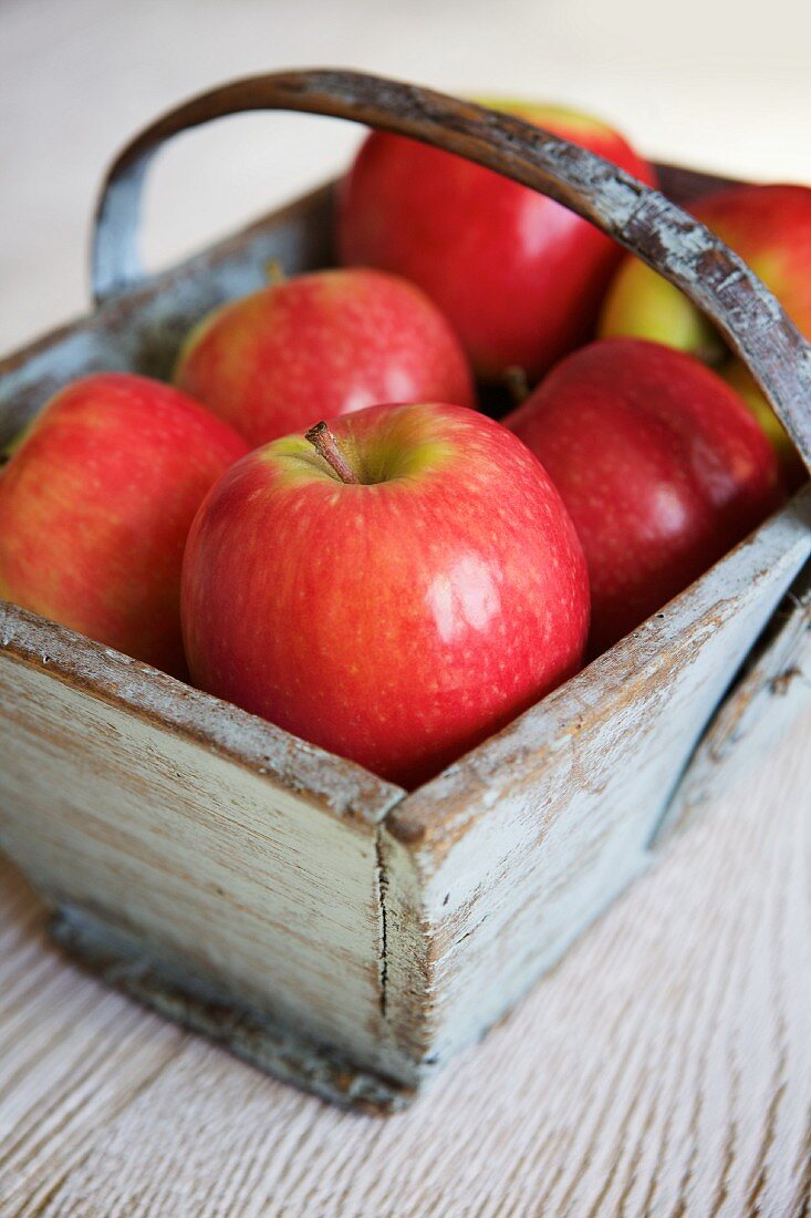 Pink Lady apples in a wooden basket