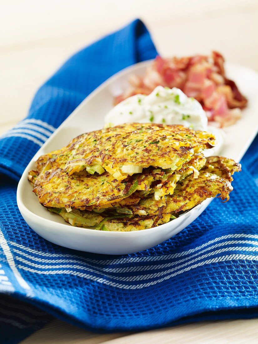 Courgette and carrot pancakes with quark and bacon