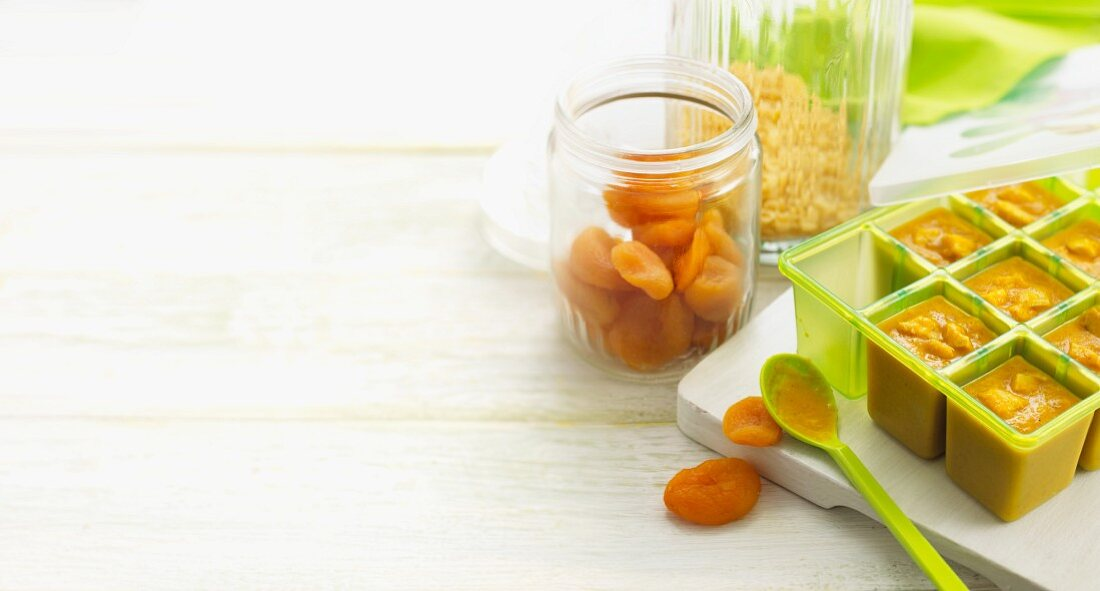 Home-made baby food with pasta and dried apricots