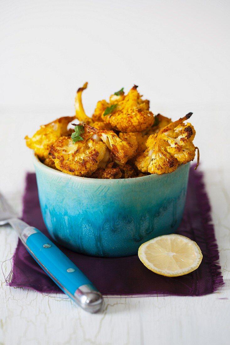 Roasted Cauliflower Bites with Spices, Garlic and Lemon