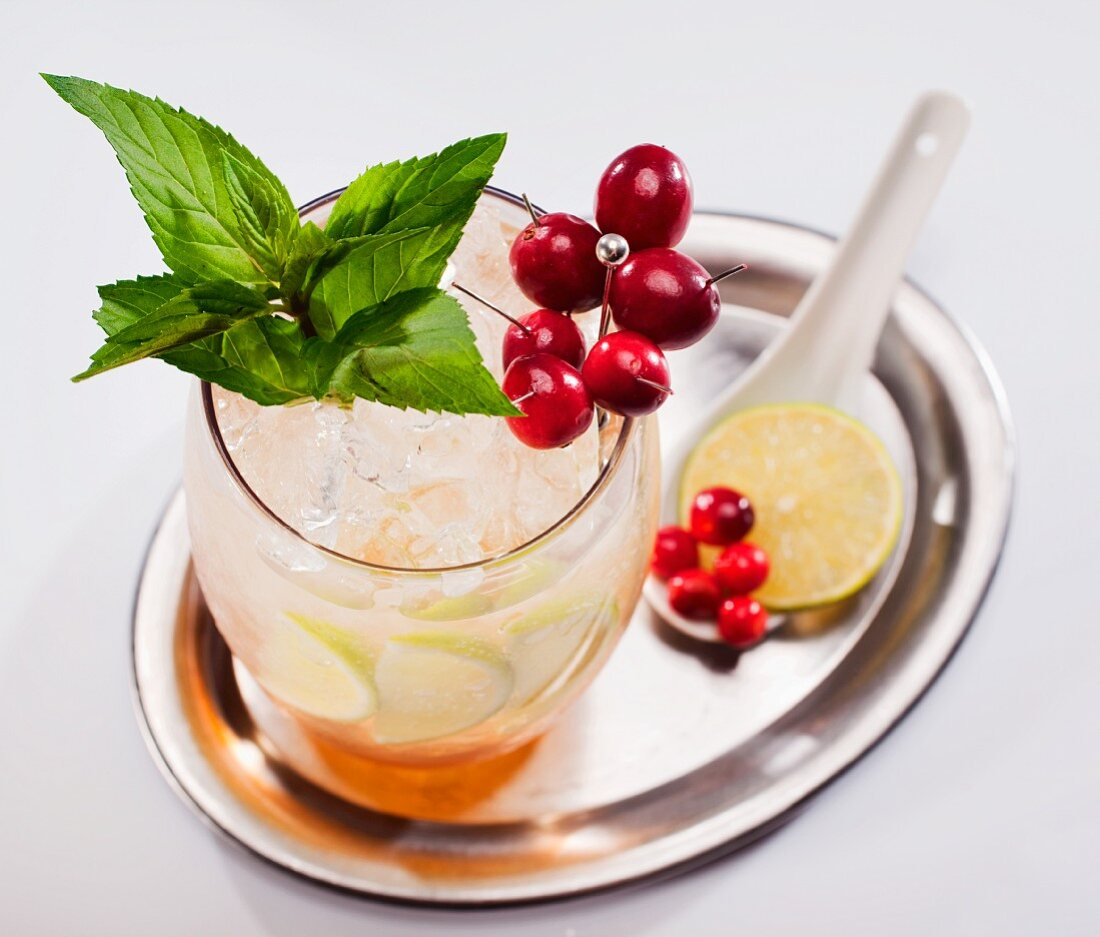 Fruit cocktail with berries and mint on a silver tray