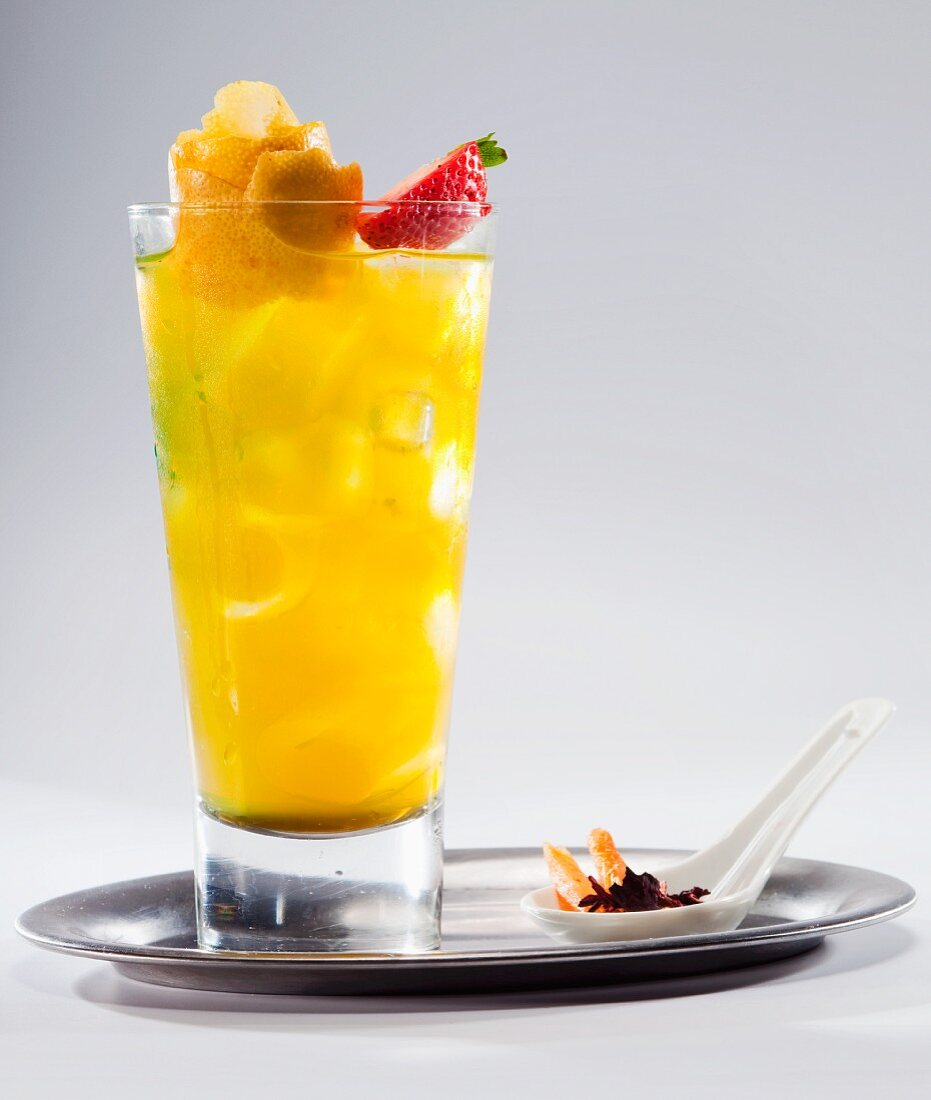 Fruit cocktail with lemon juice on a silver tray