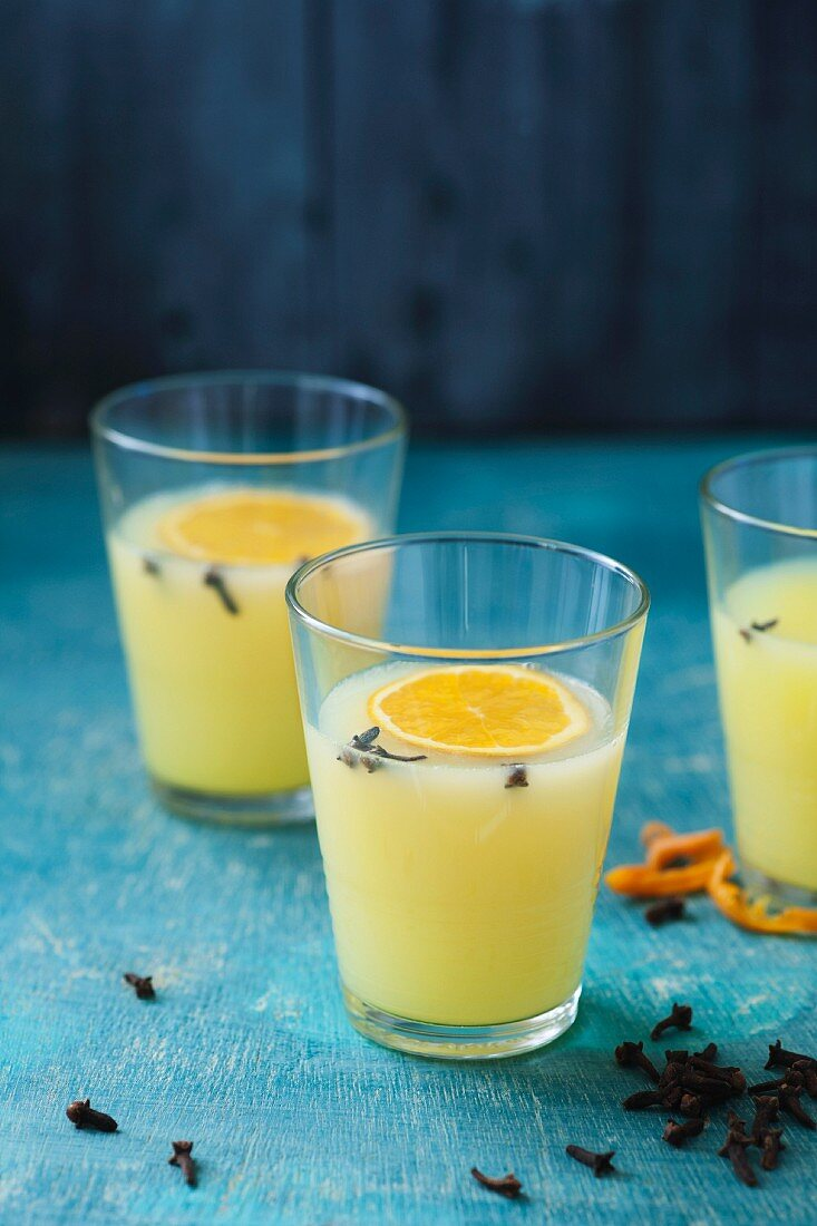 Spiced apple and satsuma punch with cloves, cinnamon and orange peel